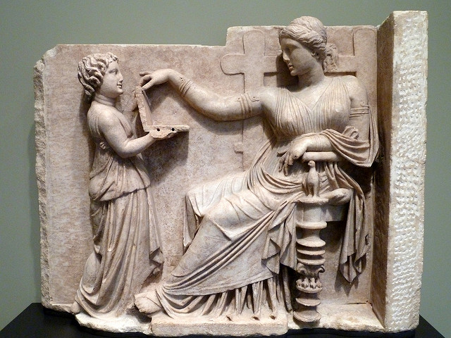 Gravestone of a Woman with Her Attendant (Greek, c. 100 BC). The hinged object was possibly a jewelry box, mirror, or wax writing tablet (probably not a laptop computer).